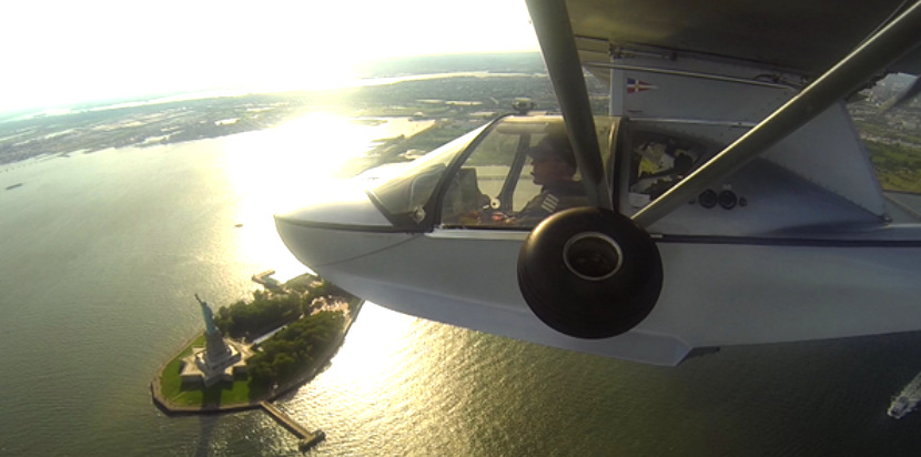 Small plane flying over the Statue of Liberty